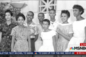 Little Rock Nine helped by President...