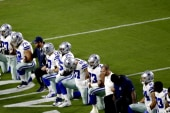 Cowboys owner Jerry Jones kneels with team...