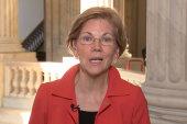 Watch Sen. Warren react to Trump calling...