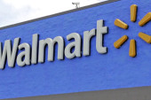 Walmart raises some workers' wages, lays off others