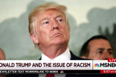 As president, Trump pokes and prods at scab of race