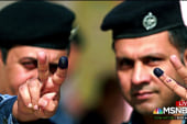 #BIGPICTURE: Iraqi policemen show off inked fingers after voting