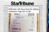 Café uses minimum wage fee