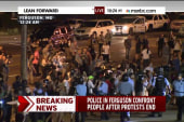 Police confront people after protests end