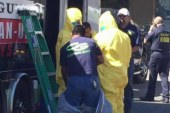 Hazmat teams cleaning Duncan family apt.