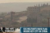 ISIS raises flag over Syrian border city