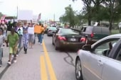 Eric Holder urges police restraint in...