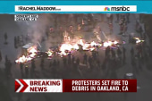 Oakland, CA protesters set fire to debris