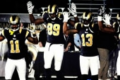 St. Louis Rams players put 'hands up' at game
