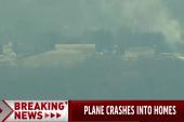 Plane crashes into homes