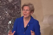 Warren rallies against bill provision on...