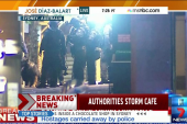 Australian authorities storm cafe