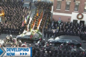 NYPD cops turn backs on de Blasio at funeral