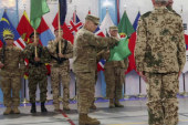 Military ceremony marks end to Afghanistan...