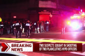 Two sought in shooting of NYPD officers