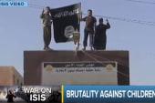 ISIS selling, crucifying children