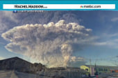 Erupting volcano covers area with ash