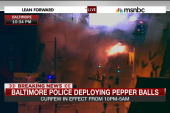 Baltimore police begin to enforce curfew