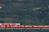Cranes work to right derailed train cars