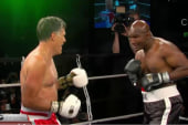 Watch Mitt Romney get in ring with Holyfield
