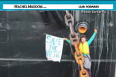 Activist ties self to oil ship anchor chain