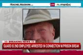 Prison guard arrested in escaped killers case