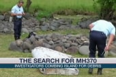 Investigators comb island for MH370 debris