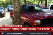 Shots fired outside Camp Shelby for second...