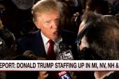 Despite controversy, Trump beefs up his staff