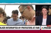 Embattled Walker pressed on immigration