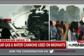 Migrants hit with tear gas and water cannons