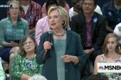 Clinton fires warning shots at Sanders, Biden