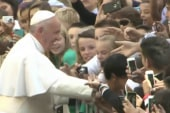 Pope greets onlookers before NYC trip