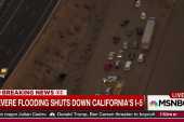 Storm blocks California freeway with mud