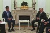 Surprise meeting for Putin and Assad