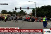 Car crashes into crowd at homecoming parade