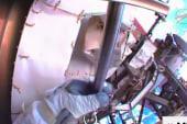 Astronauts conduct space walk