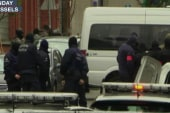 Police raids expand to Germany after Paris...
