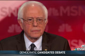 Sanders defends political background