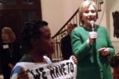 Black Lives Matter activist confronts Clinton