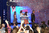 Kasich, family buried in confetti