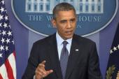 Obama defends Boehner from 'extremists'