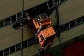 Truck dangles from New York City building