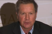 Kasich plays the health care blame game