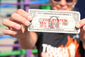 Ben & Jerry's co-founder stamps the money...