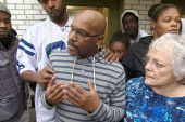 Brown's parents comfort St. Louis teen's...