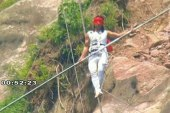 Chinese tightrope walker survives dramatic...