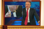 Jon Stewart shows Trump how to eat pizza