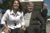 Bachmann hits golf carts, Cain sings at...