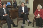 Romney and George H.W. Bush talk about chairs